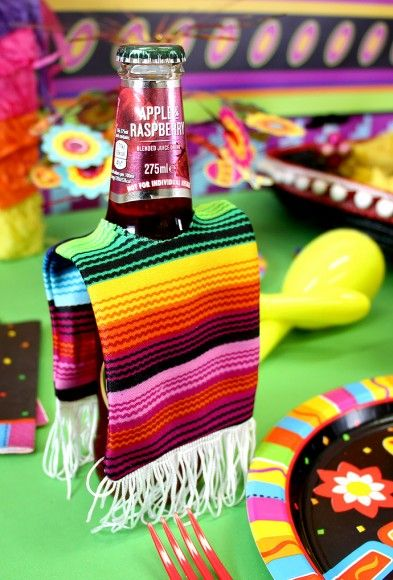 We love these Mexican fiesta beer bottle ponchos! The perfect party decoration or party food idea for a Mexican fiesta party, Cinco de Mayo celebration or Day of the Dead party!