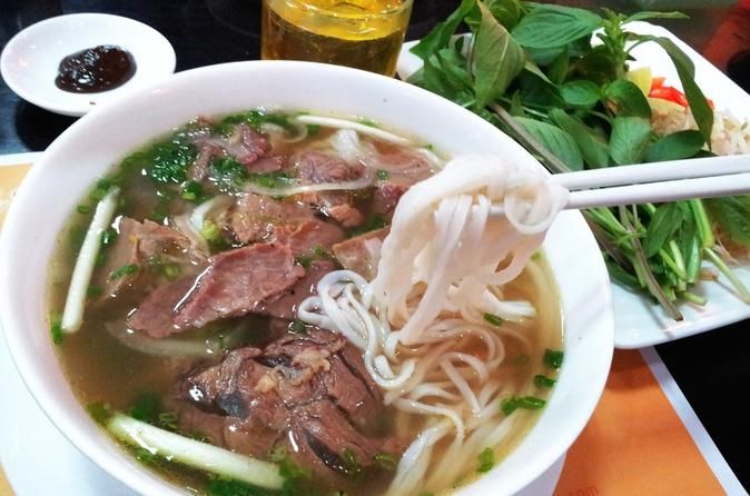 "Morning Pho Trail Food Tour in Ho Chi Minh City In this ""a morning walking tour to discover the ""Pho Trail,"" you will be taken out of the tourist area into the ""real"" Ho Chi Minh City to taste Vietnam's unofficial national dishes. During this 4-hour guided tour you will venture thorough many local markets, explore a local temple where you can you'll get your fortune read. This is a chance to explore all the backstreets and experience Vietnam as a only a local would..."