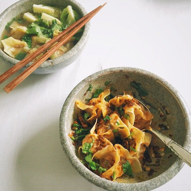 The undeniably delicious and slippery mouthfeel of pork and shrimp #wontons. For me, in chicken broth with cabbage sprouts and for him, tossed in a sichuan chilli oil vinaigrette, crispy fried shallots, garlic and chopped scallions.