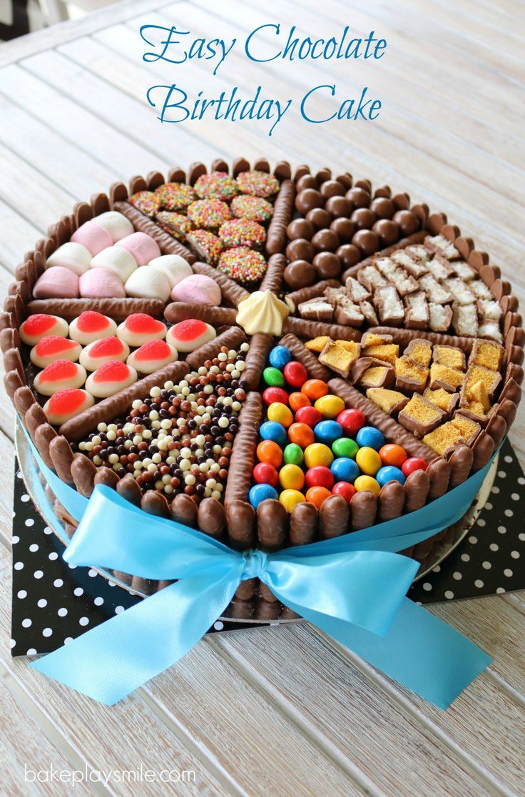 An EASY CHOCOLATE BIRTHDAY CAKE decorated with chocolate biscuits, lollies, marshmallows and chocolates! This really is a chocoholics delight!    #chocolate #birthday #cake #easy #recipe #lollies #chocolates #best #kids