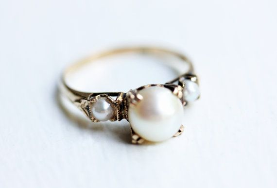 Vintage three pearl engagement ring from 1990. <3 http://www.etsy.com/listing/153652542/14k-three-pearl-ring?ref=shop_home_active