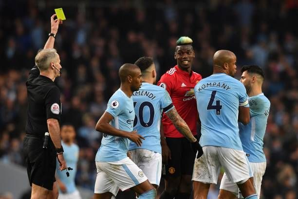 English Referee Martin Atkinson Shows A Yellow Card To Manchester Premier League Football Best Football Players Manchester United Football Club