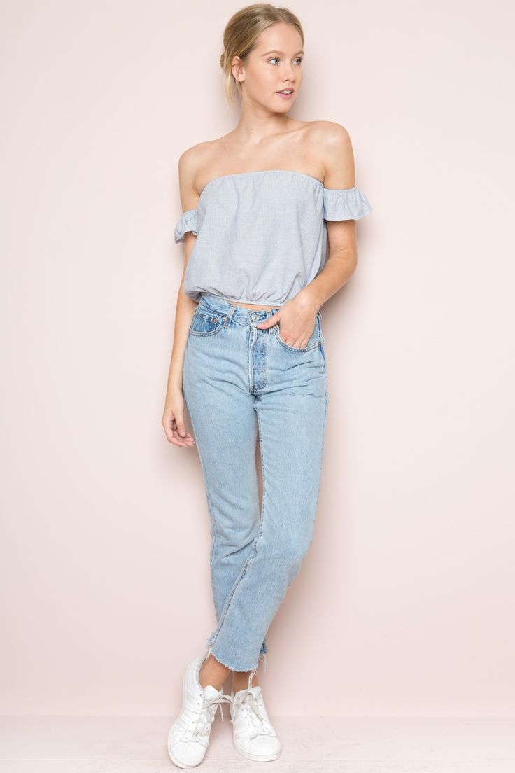 Woven cotton off-the-shoulder top in blue and white stripes with an  attached arm band with ruffled trimming, elasticized bust and waist and a  cropped fit.