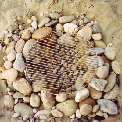 Going to the shore for the long weekend? Build a beach grill from rocks and sand!