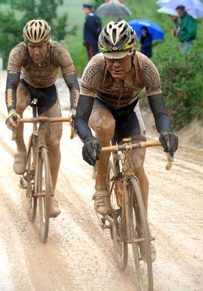 A muddy Cadel Evans on the stage to Montalcino