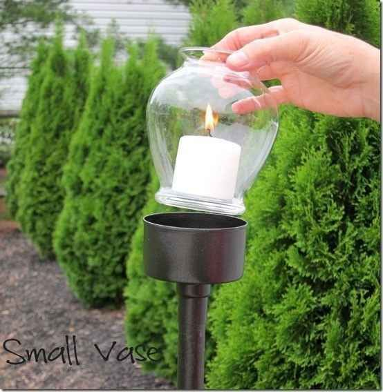 A tuna fish can, a PVC pipe, a dollar store vase, and a candle crafted together will create elegant walkway or patio lighting.