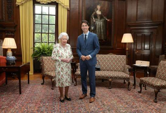 Trudeau gifts Canada Day flag to Queen | Edinburgh, Scotland - Prime Minister Justin Trudeau marked Canada's 150th birthday with the Queen Wednesday by giving her the Canadian flag that flew on the Peace Tower on Canada Day. | The Canadian Press . July 5, 2017 | REUTERS/Andrew Milligan/Pool