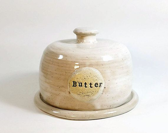 Handcrafted Farmhouse Butter Dish This one is wonderful. Throw away that old plastic container. Inside cup is 4 inches wide, and holds 2 sticks of butter. The 5 inch holds a whole pound of butter. Beautifully handcrafted. This one will make a great housewarming gifts.