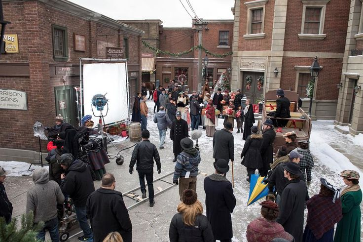 The cast and crew film scenes from A Merry Murdoch Christmas on the backlot at the Murdoch Mysteries studio.