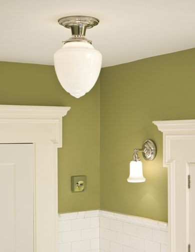 bathroom in green with white tile