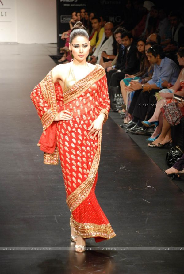 Mode walksl on the ramp of Anita Dongre''s timeless collection for spring/summer