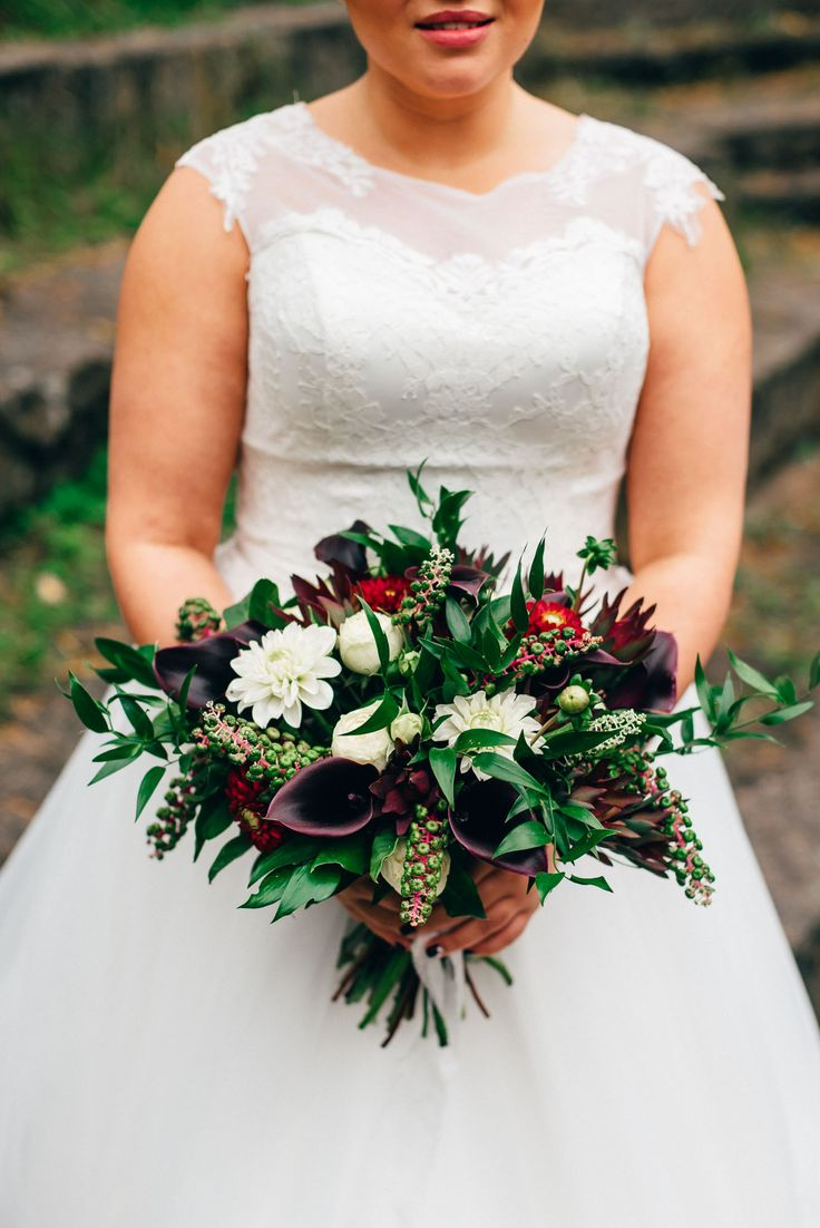 Black bouquet with calla, dahlia, ruscus, phytolacca, piano rose