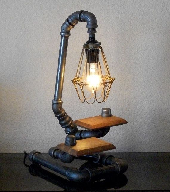 Sculptural Art Industrial Black Pipe and Reclaimed Wood Table Desk Lamp with Shade. $185.00, via Etsy.