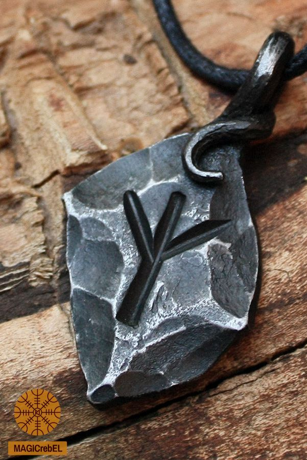 This is a forged iron hand-crafted rune pendant. Algiz rune is one of the most powerful runes of the Futhark. The Yr Rune, Algiz or Elhaz literally translates as elk. Its meanings include divinity, higher self, and the state of listening. The z-rune is the rune of the essential link or connection with the patterns of divine or archetypal consciousness, such as the Valkyrie.  #magicrebel #forged #iron #algiz #elhaz #yr #rune #viking #amulet #runic #nordic #pendant #talisman #necklace