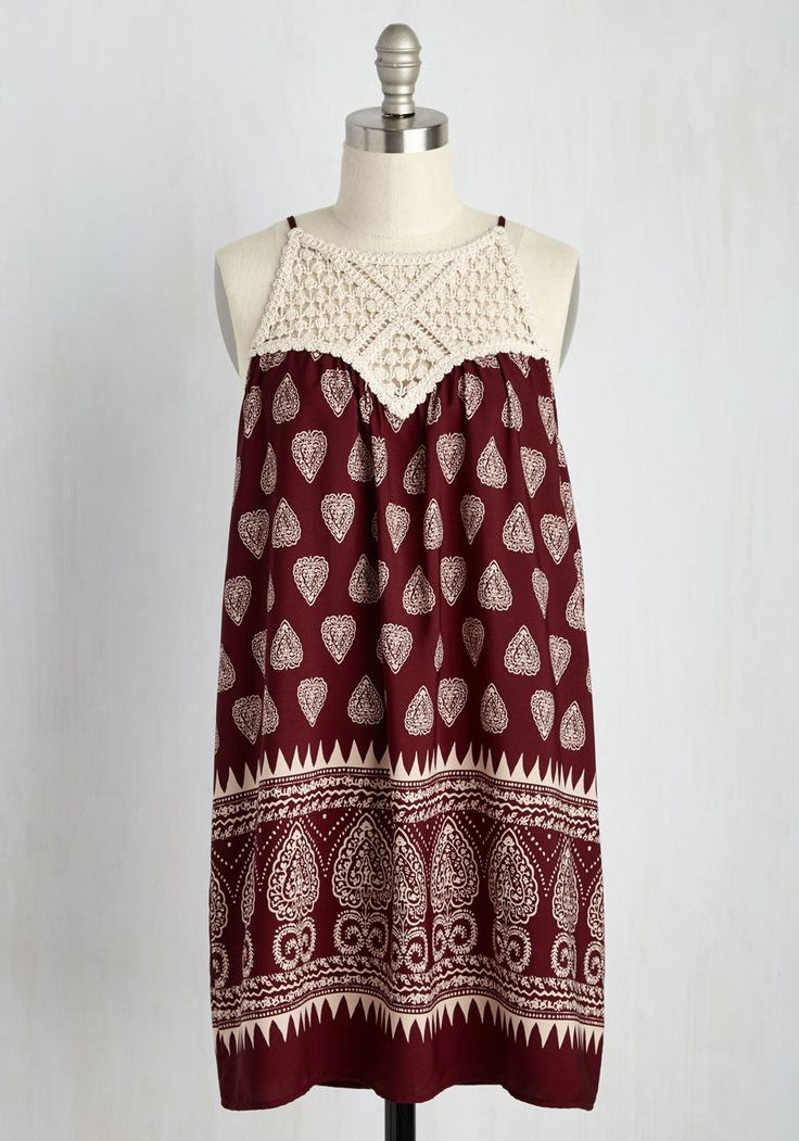 It's time to face the music - this maroon shift dress is set to inspire your next symphonic masterpiece! The ivory crocheted neckline and ornate paisley print of this boho-inspired sundress are full of creative 'tempo-tation', prompting you to go wherever the 'woodwind' takes you!
