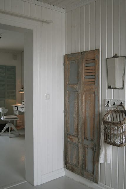 Vintage old shutter door used as a cabinet door...