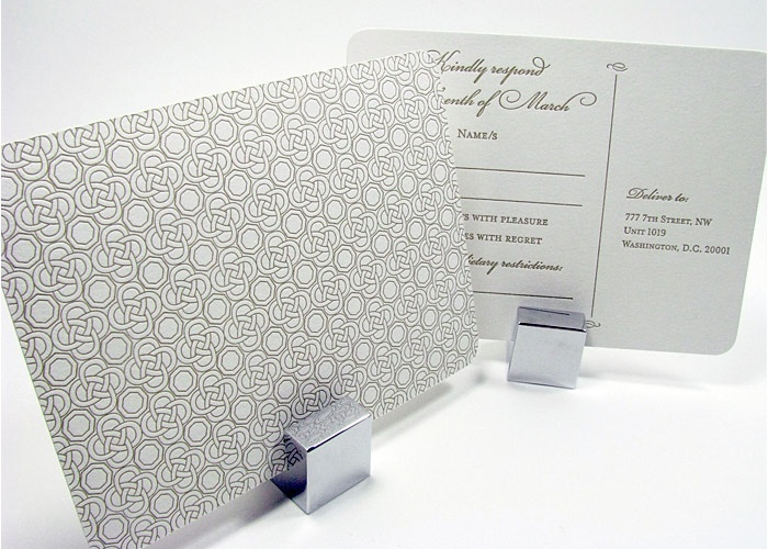 Elegant reply card with foil stamp pattern on back