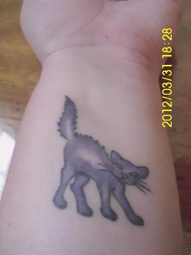 Purple cat tattoo