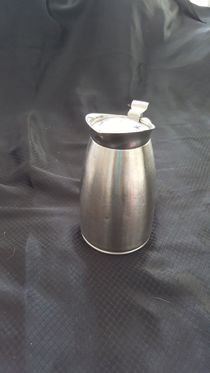 stainless steel pitcher from the 60;s by CuriosityshopDesign on Etsy