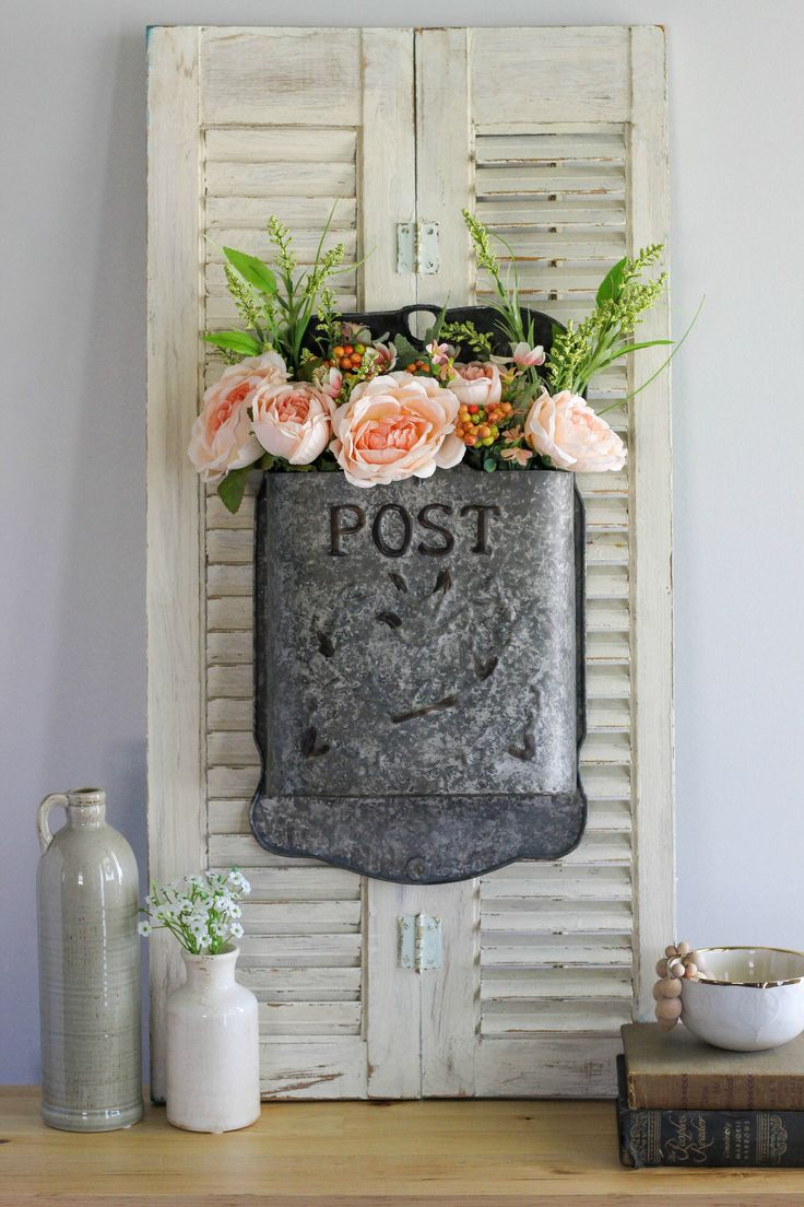 Create a simple Vintage Inspired Post Box Flower Arrangement to bring spring charm into your home using a metal embossed post box and florals.