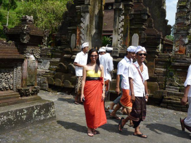 Everyone is required to wear a traditional Balinese sarong at Tirta Empul during Saraswati festival in Tampak Siring Village in Bali, Indone...