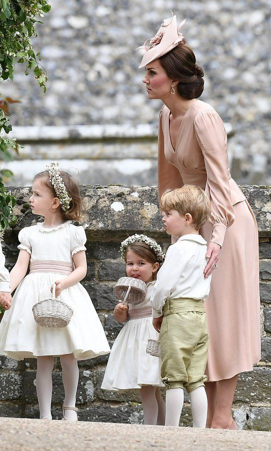 She's usually the center of attention but on this occasion Duchess Kate played a supporting role, helping to keep the wedding on track.    Photo: Getty Images