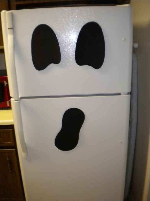 If you have a fridge and black paper, you have a ghost. | 27 Incredibly Easy Ways To Upgrade Any Halloween Party