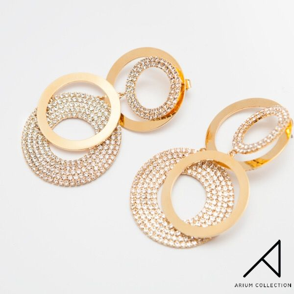 Our earrings from the Sunshine Collection are all about the gloss and soft shapes. Inspired by the contours of the sun they bring you a playful Bohemian vibe. Available in gold and rhodium plated brass.  Handmade in South Korea.  #ariumcollection #costumejewelry #earrings