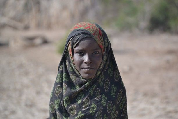 Danakil Depression, Afar, Ethiopia — by Earthseeing. A curious girl in the middle of the Ethiopian desert at Danakil Depression. She was very happy and proud to have her...