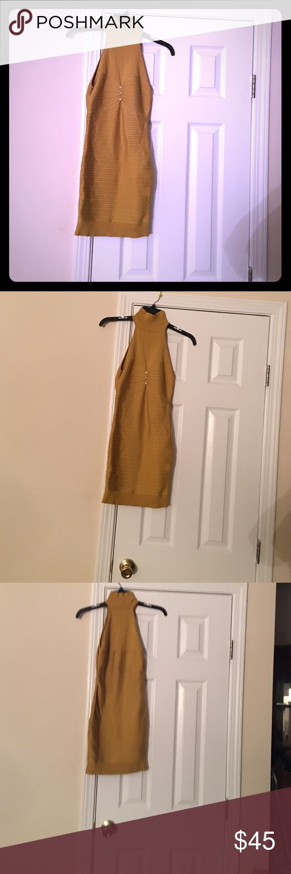 Marciano silk/door and nylon and spandex . Beautiful diamond buttons gold  in color can be wear as top or  dress. Guess by Marciano Dresses Mini