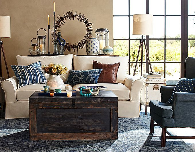 living room sofa trunk table driftwood wreath pottery