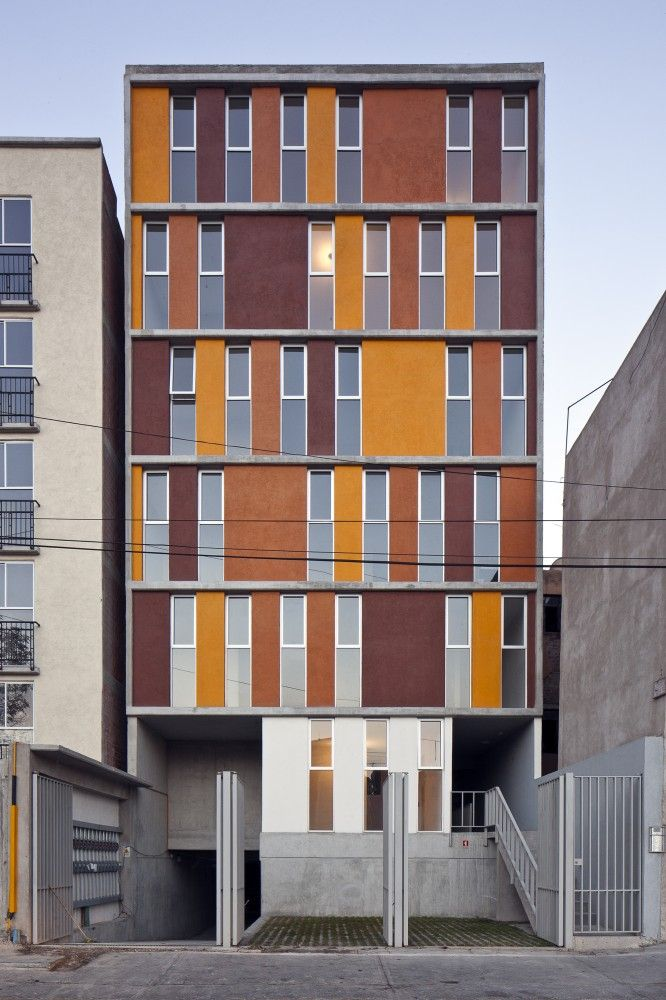 ITI 68 / C Arquitectos wonderful repetition of warm browns, golds and rusts break up facade of building into dynamic visual piece