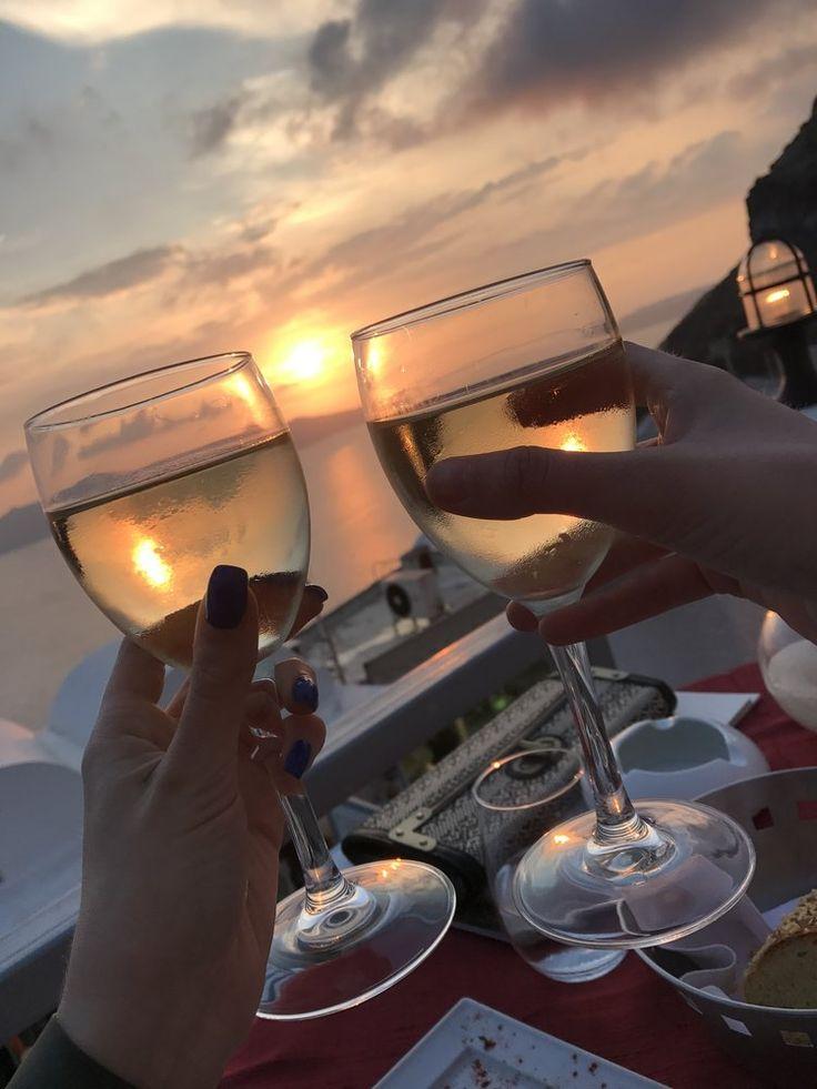 Santorini Sunset with Wine — ally Santorini Greece island fashion travel https://www.allyblog.com/home/santorini-sunset