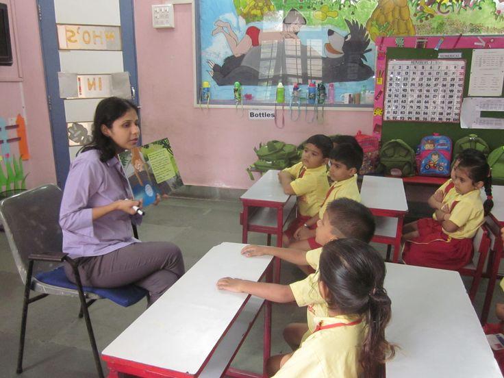 Chetana teacher explaining the students very interestingly the stories.