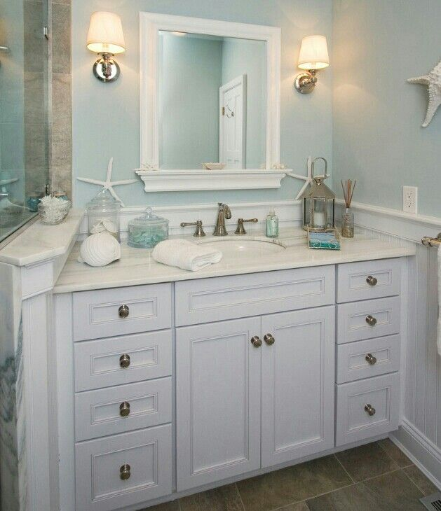Beach theme bathroom i like the mirror and wall color for Bathroom color theme ideas