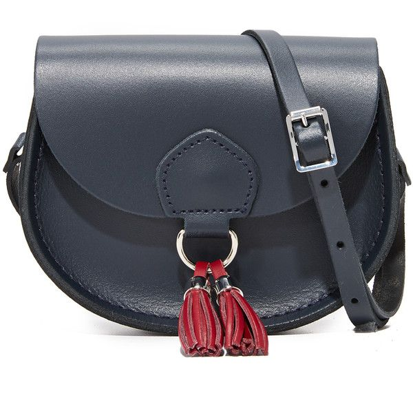 Cambridge Satchel Mini Tassel Bag ($125) ❤ liked on Polyvore featuring bags, handbags, shoulder bags, navy rhubarb, navy leather handbag, navy shoulder bag, leather shoulder bag, saddle bags and mini purse