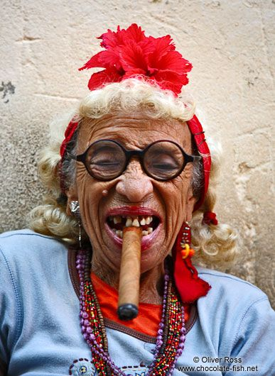 Woman with cigar. This lady is a frequent Havana-picture-participant. In fact, that's what she makes a living of – being photographed by tourists.