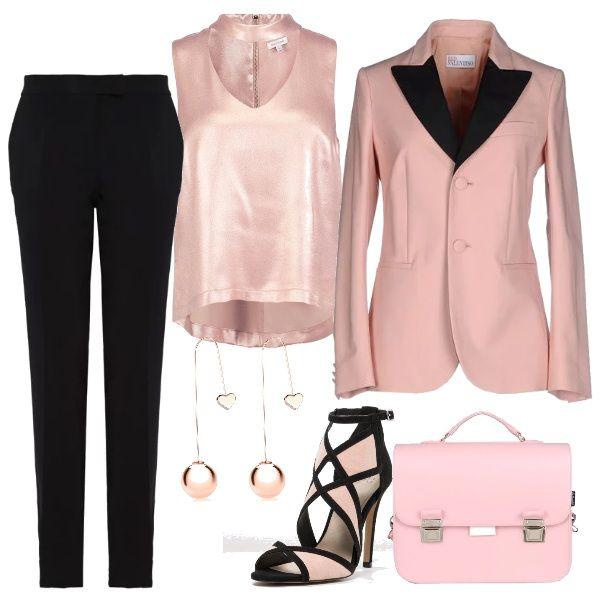 Outfit adatto per una cerimonia o per un incontro d'affari. Il revers a lancia della giacca accentua l'eleganza del completo. Scarpa molto femminile nella stessa colorazione rosa e nero del completo. Top di raso minimal. Cartella rosa cipria porta lap top.