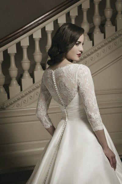 Style #8695 features delicate lace sleeves for the traditional style bride I @Justin Alexander I http://www.weddingwire.com/wedding-photos/dresses/justin-alexander/i/61a4ef4fbfd53b7c-dafb754575744920/76bfe3e2cb44654a