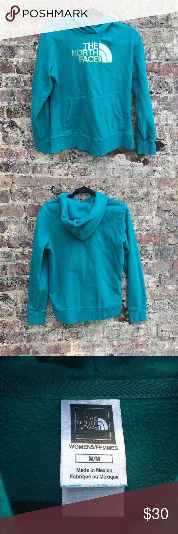 North face hoodie North face teal green hoodie with gold lettering. Women's size medium. North Face Tops Sweatshirts & Hoodies