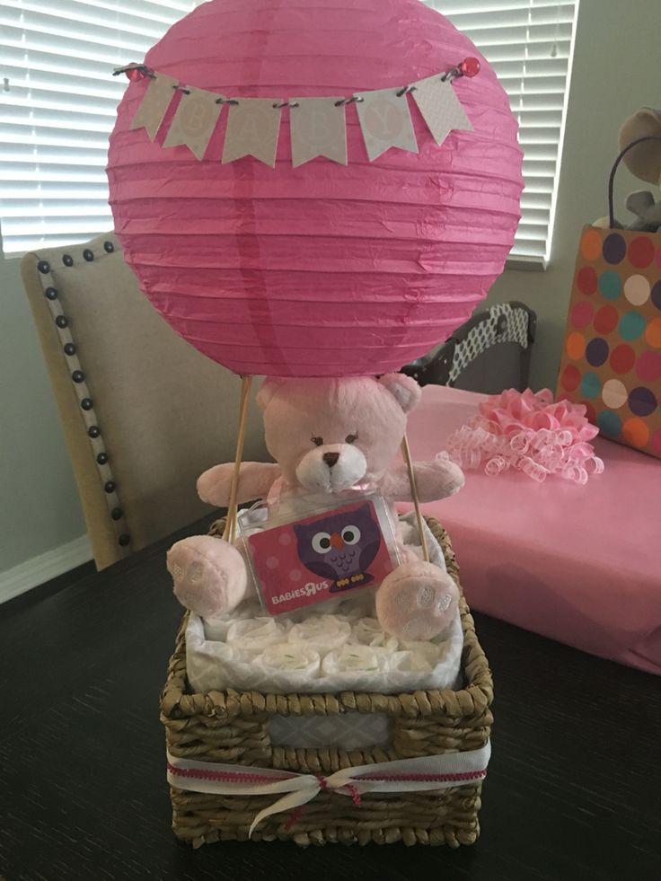 Hot air balloon diaper cake  Baby shower decor  Baby shower  Paper lantern, basket, banner, Kebob sticks, stuffed toy, diapers, receiving blanket, ribbon.