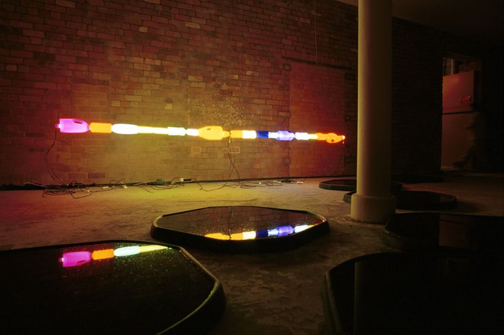INTENCITY. installation at Designers Block in the Jam Factory Building. Light and colours reveal an industrial space, while fragments of life reflect romantically into black pools of water forming an indoor landscape.  Photography: Carlo Draisci