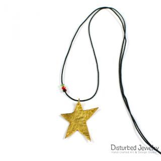 This is a sterling silver 925 handcrafted star pendant. It looks like melting and it is plated with 14K yellow gold. Has mixed brush finish and delivered with black adjustable cord of flax, with tiny crystals.