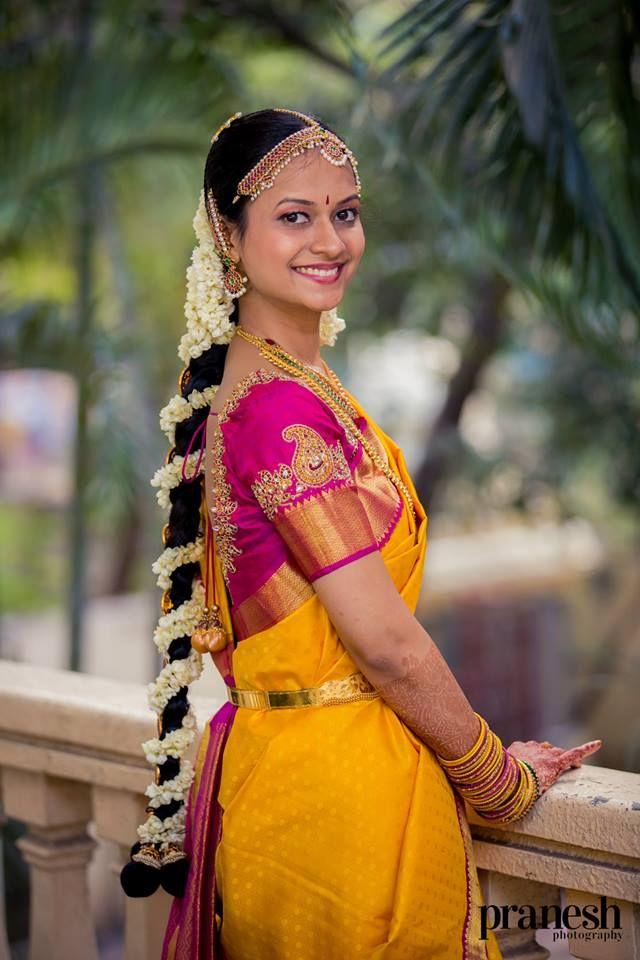 South Indian bride. Temple jewelry. Yellow silk kanchipuram sari. Braid with fresh flowers. Tamil bride. Telugu bride. Kannada bride. Hindu bride. Malayalee bride.