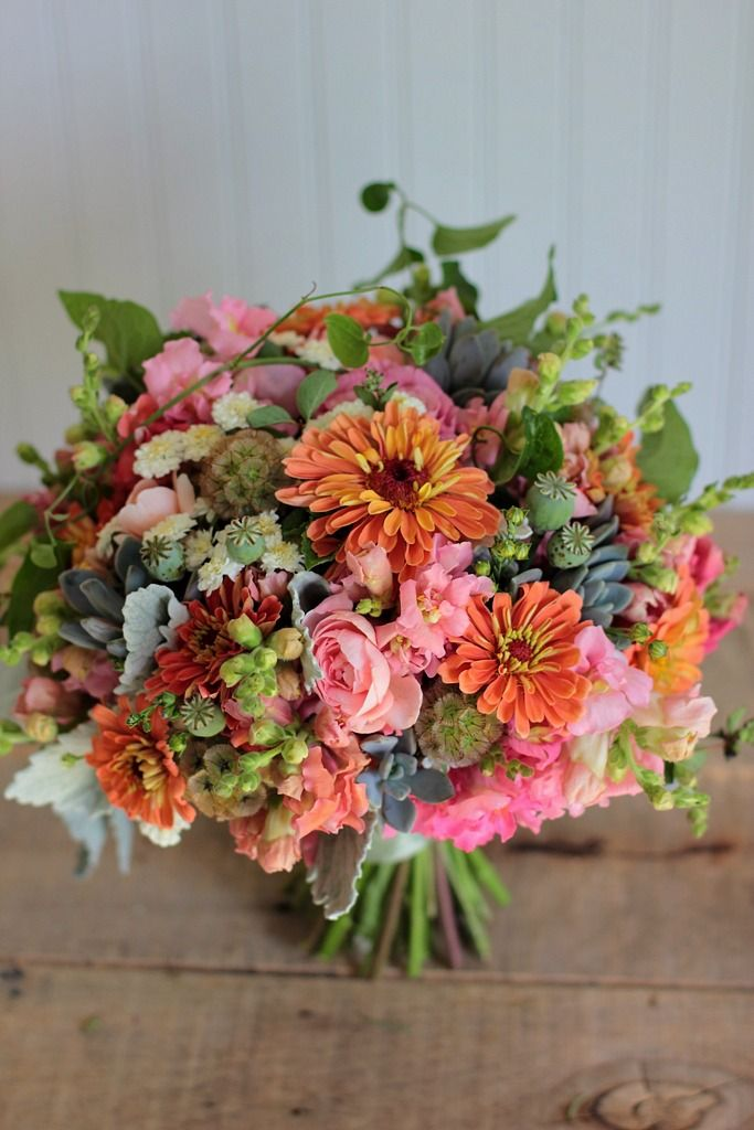 Seasonal, Rounded textural Mid-July bridal bouquet in sunset tones; designed by Love 'n Fresh Flowers
