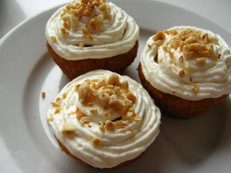 Carrot cupcakes with creamcheese frosting and roasted almonds
