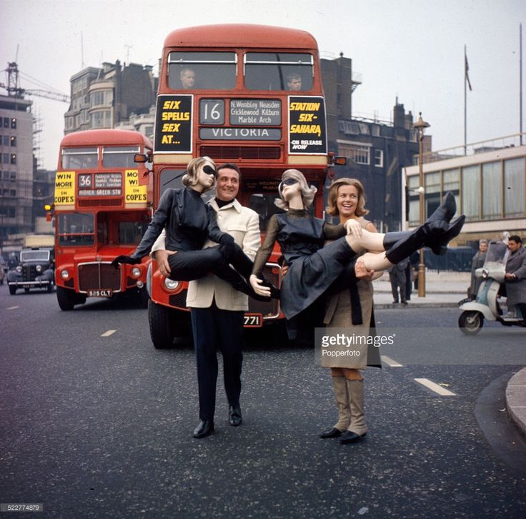 English actress Honor Blackman and English actor Patrick Macnee posed together holding mannequins to promote the television series 'The Avengers' in Park Lane, London in 1964.