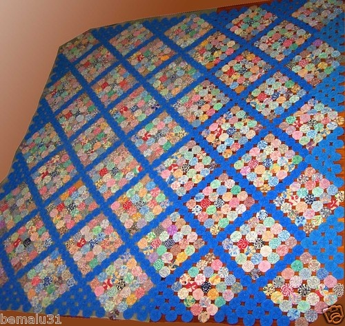Antique Yoyo quilt made from feedsack prints ... beautiful work!