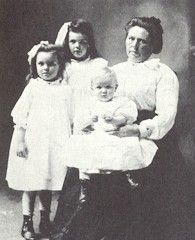 Belle Gunness with her three children. No one expected the sturdy hog farmer to be a lethal seductress -- and serial killer.
