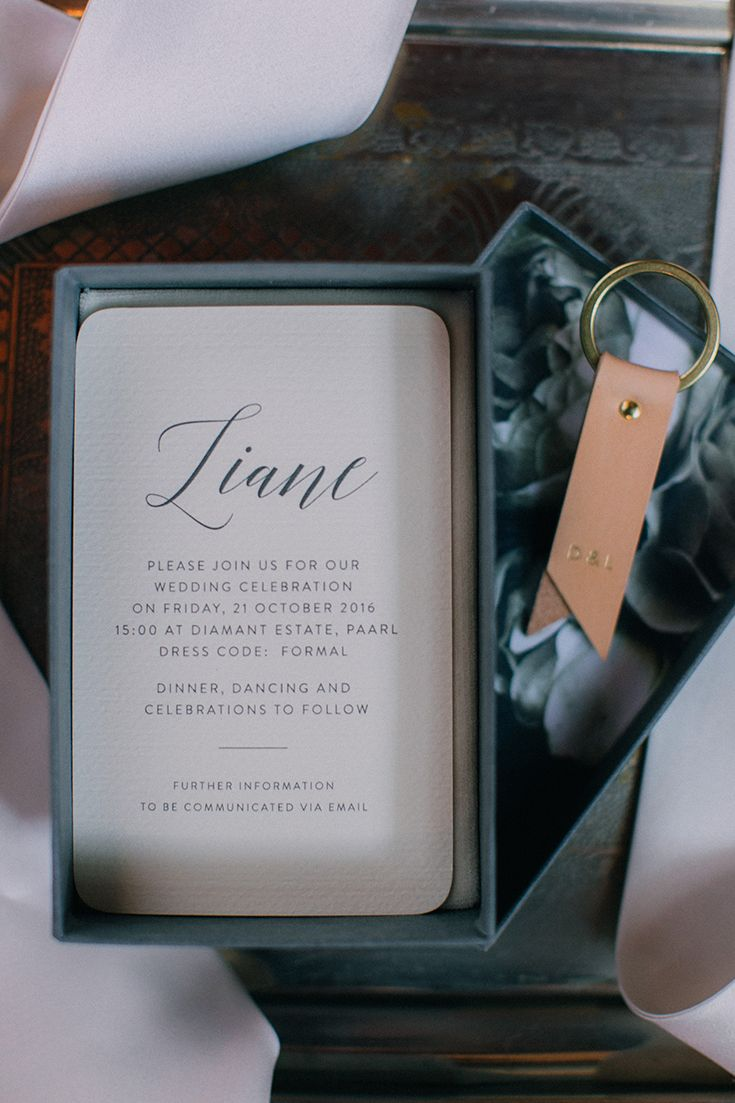 What a unique invite idea! Lucille & Dries created a Custom designed gold foiled invitation box with the wedding invite inside and a custom leather key chain for each guest.